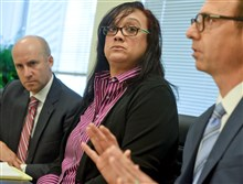 Renita Hill of Baldwin Borough listens to attorney George Kontos during a press conference earlier this year.