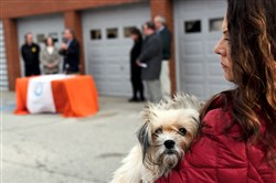 Frannie Jennings holds her rescued dog, Aggie, during a rally at the Western Pennsylvania Humane Society in 2015.