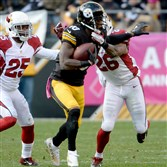 Steelers' WR Martavis Bryant -- given a thumbs up for this weekend's fantasy football action -- carries as he's defended by the Cardinals' Rashad Johnson in the third quarter Sunday at Heinz Field.