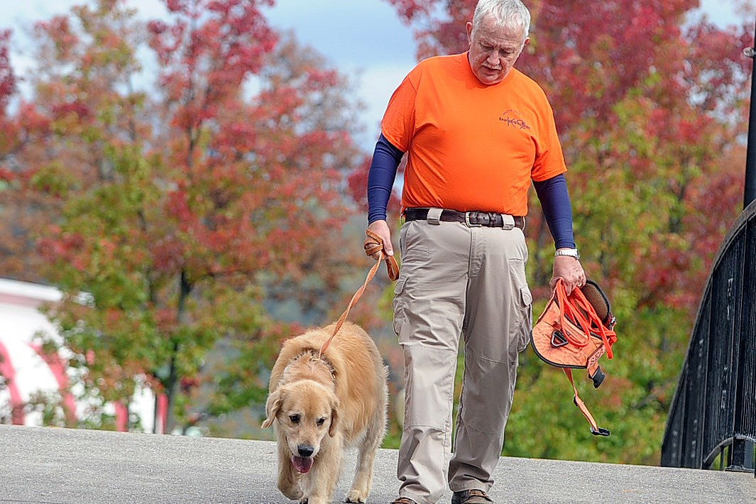 John Osheka of Conway and Sundance, his golden retriever, return from participating in the K-9 Search and Rescue training at Kennywood in October. Sundance, who died in January, was one of the first dogs registered in the Golden Retriever Lifetime Study.