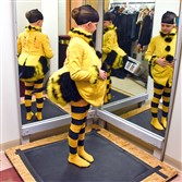 "Ellis Mcenroe, 9, tries on her bee costume for the Pittsburgh Ballet Theatre's production of ""The Nutcracker."""
