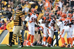 Steelers quarterback Ben Roethlisberger walks off the field disgusted after throwing an interception in the fourth quarter against the Bengals Sunday at Heinz Field.
