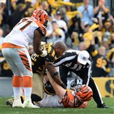 James Harrison, shown here mixing it up with Bengals OL Eric Winston earlier this month at Heinz Field, is expected to play Sunday in Seattle.