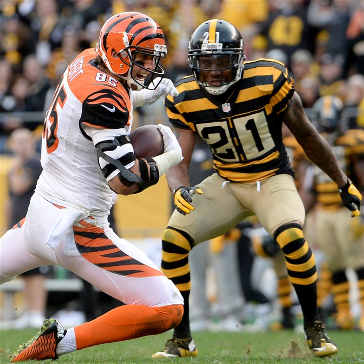20151101mfsteelerssports16-4 The Steelers' Robert Golden looks to make a tackle on the Bengals' Tyler Eifert during a Nov. 1 game at Heinz Field.