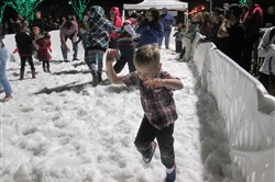 Children play in the snow field at 2014's Glendale Glitters. Rob Owen/Post-Gazette