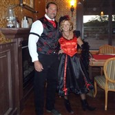 Michael and Nancy Ferrell of Moon, part owners of the Tombstone Monument Guest Ranch near Tombstone, Ariz., in Old West costumes for a party.