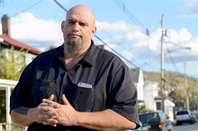 Braddock Mayor John Fetterman on Comrie Avenue. Mr. Fetterman partnered with Peoples Natural Gas last winter in a door-knocking campaign to connect low-income residents with heating service.