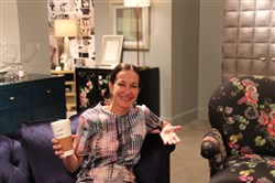 Designer Cynthia Rowley enjoying a room full of her new collection for Hooker Furniture.