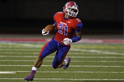 Running back Khaleke Hudson #21 of McKeesport rushes against Seneca Valley on November 6, 2015.