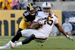 Steelers' CB Ross Cockrell takes down Raiders' Michael Crabtree in the third quarter Sunday at Heinz Field.