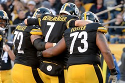 Steelers quarterback Ben Roethlisberger is helped off the field after getting sacked by Raiders' Aldon Smith in the fourth quarter at Heinz Field Sunday.