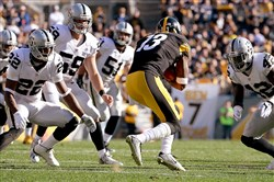 Steelers' WR Jacoby Jones can't find any running room on a kickoff return against the Raiders in the first quarter Sunday at Heinz Field.