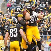 Steelers TE Jesse James celebrates his 4th quarter touchdown with teammates during the game against the Oakland Raiders at Heinz Field on Sunday.