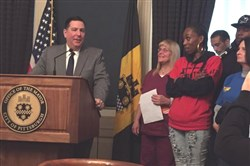 Mayor Bill Peduto at City Hall on Nov. 10, 2015, when he signed an executive order raising the minimum wage for about 300 city workers to be phased in over five years. On Monday the mayor introduced legislation that would require large city contractors to pay at least $15 per hour to full-time workers.