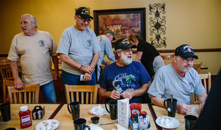 20151105arVietnamVets02-1 Vietnam veterans Rich Lee, 71, of Oakdale, Army: George Coppola, 68, of Collier, Coast Guard; Gino Jesensky, 69, Baldwin, Army; and Dave Laepple, 67 of Crafton, Army, talk after breakfast at Gianna Via's Restaurant in Whitehall.