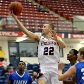 Duquesne's Micah Mason drives to the net against Urbana Tuesday in the first half at the Palumbo Center.