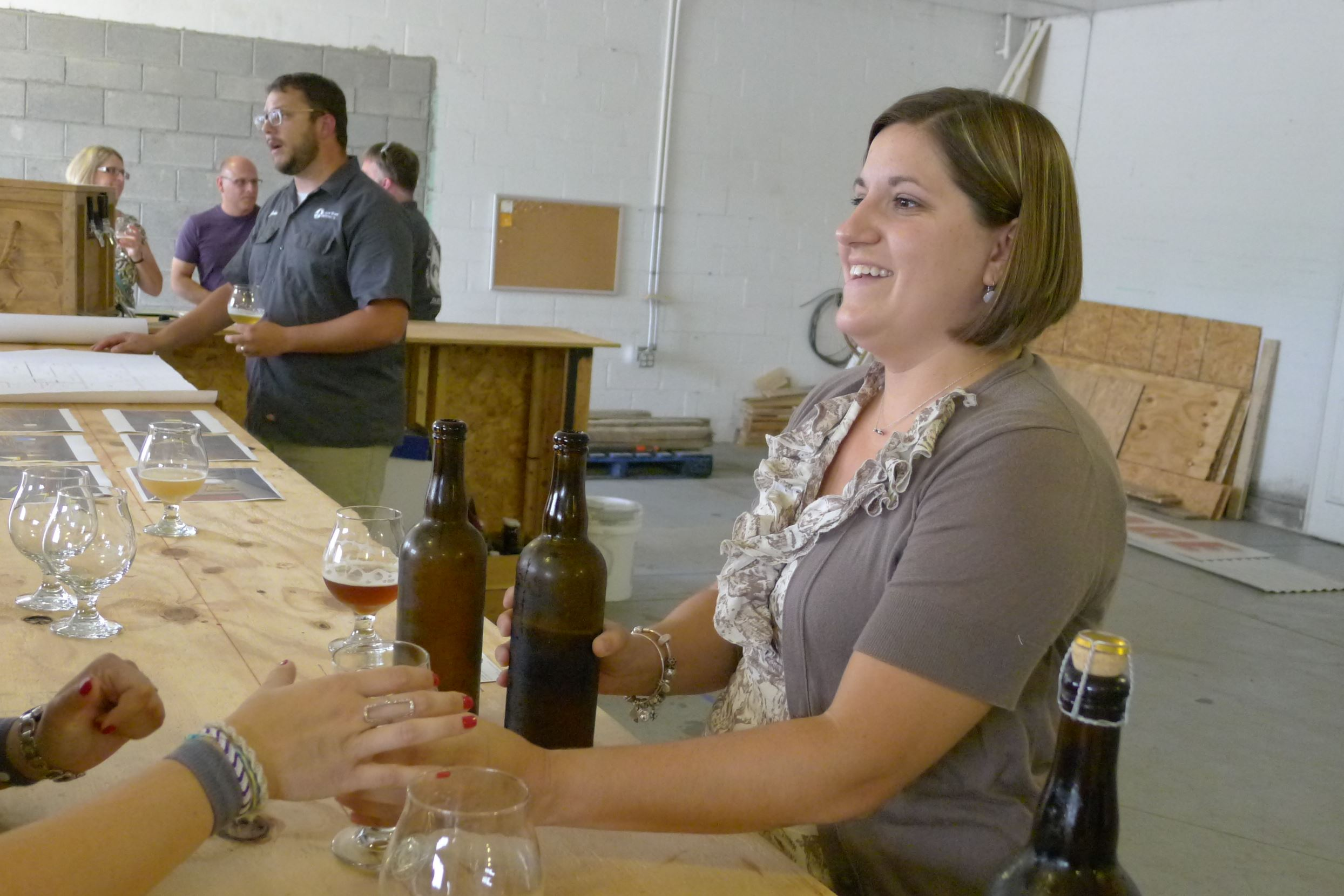 P1260084 Laura Latcher pours visitors tastes of brew at Cellar Works Brewing in Sarver. Helping her work the bar, behind her, is her husband, John Latcher.