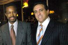 Dr. Ben Carson, left, and Alfonso A. Costa in December 2005.