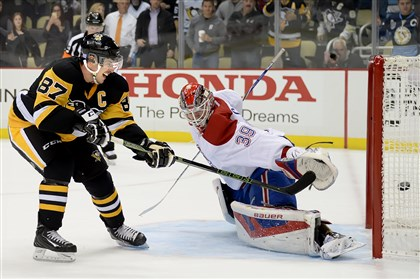 Penguins center Sidney Crosby scores during shootout against Montreal Canadiens goalie Mike Condon on Nov. 11 at Consol Energy Center. After a slow start to the season, Crosby is the NHL's hottest player.