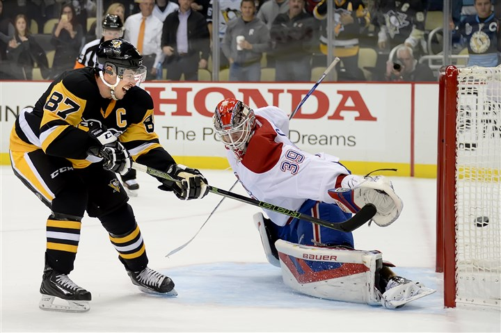 20151111pdPenguinsSports06 Penguins center Sidney Crosby scores during shootout against Montreal Canadiens goalie Mike Condon on Nov. 11 at Consol Energy Center. After a slow start to the season, Crosby is the NHL's hottest player.