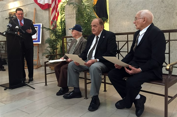 20151111ZulloVets Mayor Bill Peduto, left, reads a proclamation honoring Paul Gaudi, 91, of Jeannette, George Jock, 89, of Somerset, and Robert McKnight, 89, of Connellsville, who served aboard the USS Pittsburgh during World War II.