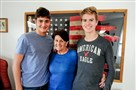 Alexander Pedersen of Denmark, left, and Toro Tommola of Finland, right are spending their first American Thanksgiving with their host mother, Darlene Frederickson of Greensburg. The juniors in high school traveled to Greensburg through AFS-USA, a foreign exchange program that brings together host families and students.