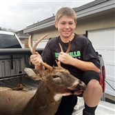 Colin O'Farrell, 12, of Dormont, shot his first deer, a 6-point taken with a cr