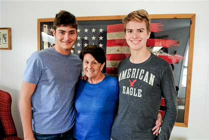 Alexander Pedersen of Denmark, left, and Toro Tommola of Finland, right, are spending their first Thanksgiving with their host mother, Darlene Frederickson of Greensburg.