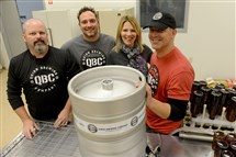 From left, Arty Quinn, brew master; Paul Stinelli, sales; Erika Quinn and her husband, owner Alan Quinn pose for a portrait inside Quinn Brewing Co. in North Huntingdon.