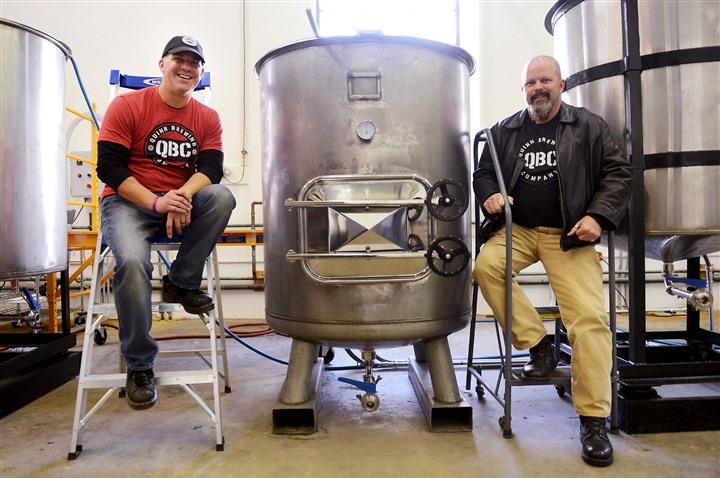 20151114MWHbrewerySunMag02-1 Owner Alan Quinn, left, and his brother, brew master Arty Quinn, inside Quinn Brewing Co. in North Huntingdon.