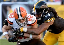 Root for whom? In 2015, the Steelers' Jarvis Jones takes down Browns' Gary Barnidge.