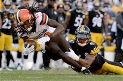 Steelers cornerback Antwon Blake takes down Cleveland receiver Travis Benjamin, who had 11 receptions for 113 yards but no touchdowns Sunday at Heinz Field.