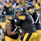 The Steelers' Ramon Foster congratulates quarterback Ben Roethlisberger after he threw a touchdown pass to Antonio Brown in the fourth quarter Sunday against the Browns at Heinz Field.