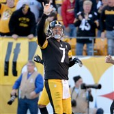 Steelers' quarterback Ben Roethlisberger celebrates one of his three touchdowns Sunday against the Browns.
