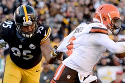 Steelers' Jarvis Jones reaches to try to take down Browns quarterback Johnny Manziel in the third quarter last Sunday at Heinz Field.