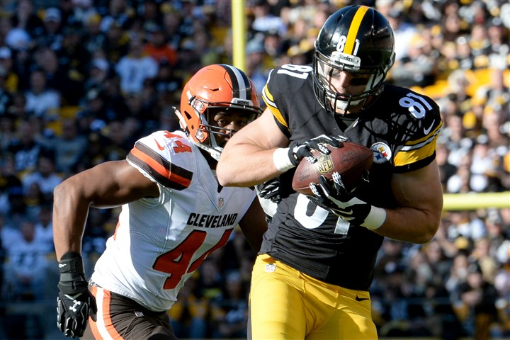 20151115mfssportssteelers05-3 Steelers tight end Jesse James pulls in a pass as he's defended by the Browns' Nate Orchard during a November game at Heinz Field.