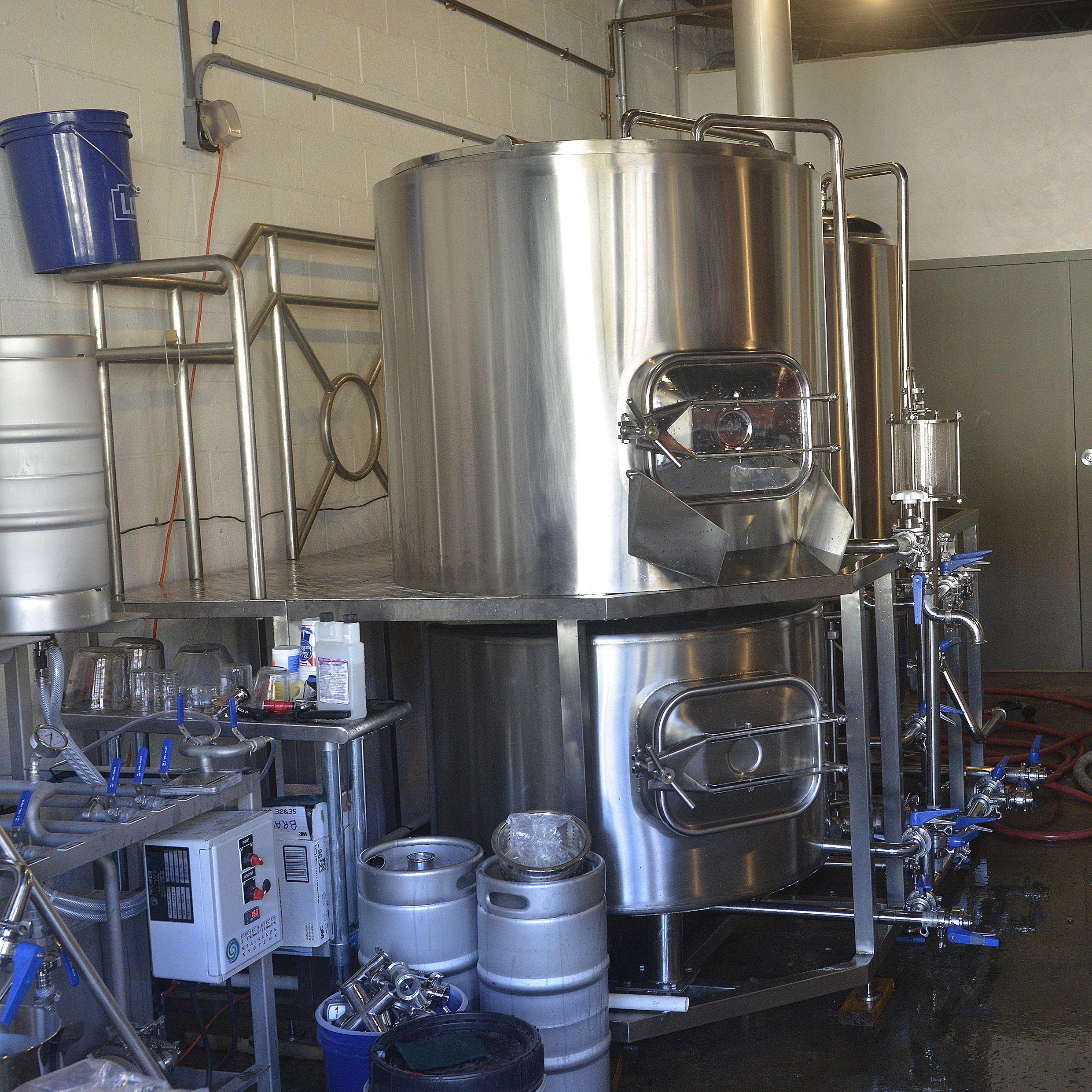 20151115lrinsurrectionmag04-10 Fermentation tanks for the Insurrection AleWorks.