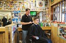J.R. Hoffman gives Mitchell Grunwald, 16, a haircut in Mr. Hoffman's barber shop, the Great Southern Barber Shop, in Bridgeville. The barber shop has been open in the same plaza for 60 years and is one of the only original business left in the plaza.