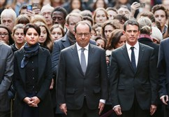 French President Francois Hollande, center — flanked by Prime Minister Manuel Valls, right, and Education Minister Najat Vallaud-Belkacem, left — stands among students Monday during a minute of silence at Sorbonne University in Paris in memory of the victims of Friday's terrorist attacks.