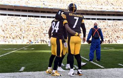 Ben Roethlisberger and Antonio Brown celebrate on the sidelines after a blowout win over the Browns in 2015.