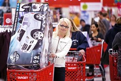 One in five consumers complain that paying with a chip card takes too long. Above, Sheila Bullock, 28, carries a toy car in her cart at a Target store in Phoenix.