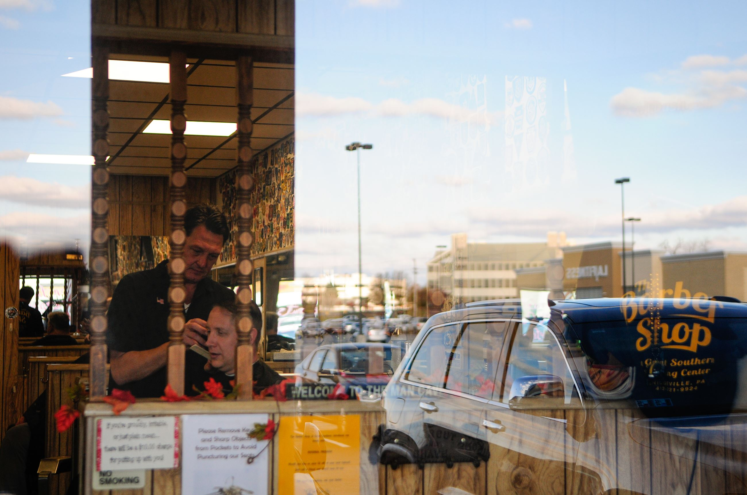 ... Shopping Plaza is mirrored off of J.R. Hoffmans barbershops window