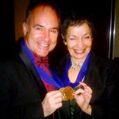 Stephen Flaherty and Lynn Ahrens display their heavy brass medallions, presented in New York Monday for their induction into the Theater Hall of Fame.
