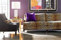 The Drake sofa by Lillian August for Hickory White in a bold leopard print.