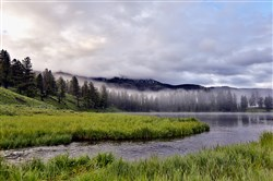"Morning mist floats over Trout Lake in Yellowstone National Park, featured on the new Nat Geo Wild series ""Wild Yellowstone."""