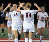 Upper St. Clair's Elaina Walnoha, left, celebrates the team's second goal against undefeated Norwin winning 2-1 the PIAA semi-final match and a trip to the state championship in Hershey.
