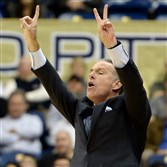 Pitt head coach Jamie Dixon calls out a play to his team against St. Joseph's in the first half last week at the Petersen Events Center.