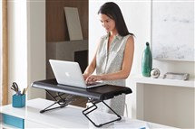 A semi-portable Varidesk Soho standing desk, $175 at varidesk.com.