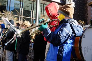 Liam Shields,10, of Hampton plays the trumpet at the Pittsburgh Creche outside the U.S. Steel Tower on Grant Street.