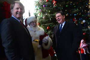 Allegheny County Executive Rich Fitzgerald, left, shares a laugh with Santa Claus and Mayor William Peduto at the City-County Building after officially kicking off Pittsburgh's holiday festivities on Light Up Night.